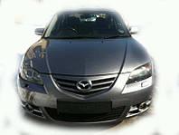 Бампер передний Mazda 3 sedan