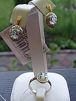 Набор серебряный с золотыми вставками и голубыми топазами