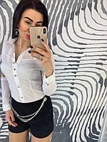 Белая женская рубашка с вышивкой на рукавах