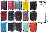 Средний пластиковый чемодан Wings 147 на 4 колесах