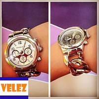 Женские наручные часы Michael Kors.
