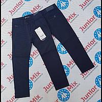 Детские котоновые брюки синего цвета в мелкую клетку для мальчиков  оптом GRACE
