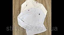 Гольф шкільний для дівчинки 9-12 років білого, молочного кольору з вишивкою оптом