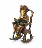 Ганеша в кресле читает книгу, статуэтка