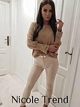 Блуза в однотоне с красивыми рукавами