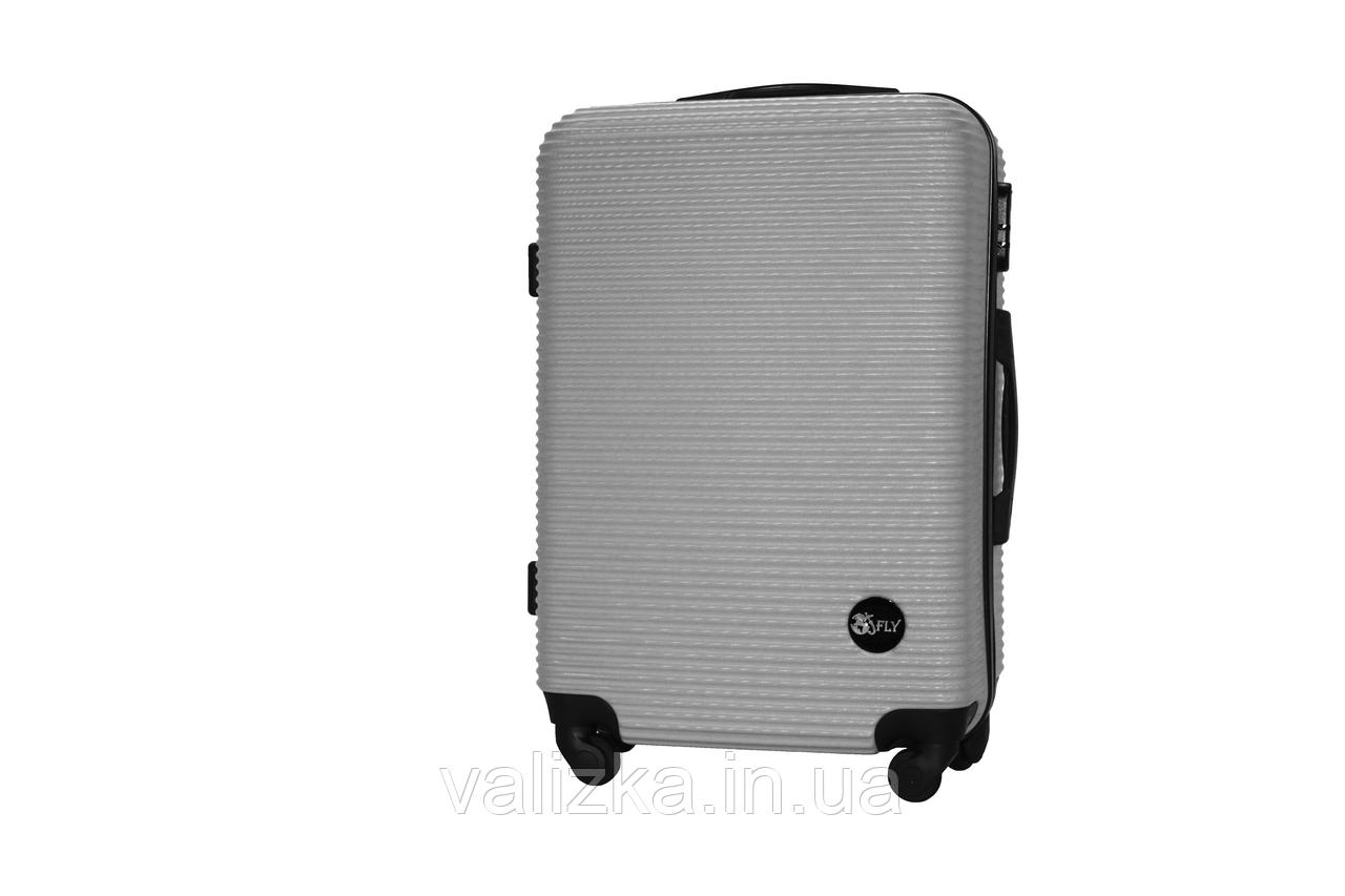 Средний пластиковый чемодан на 4-х колесах серебро Fly