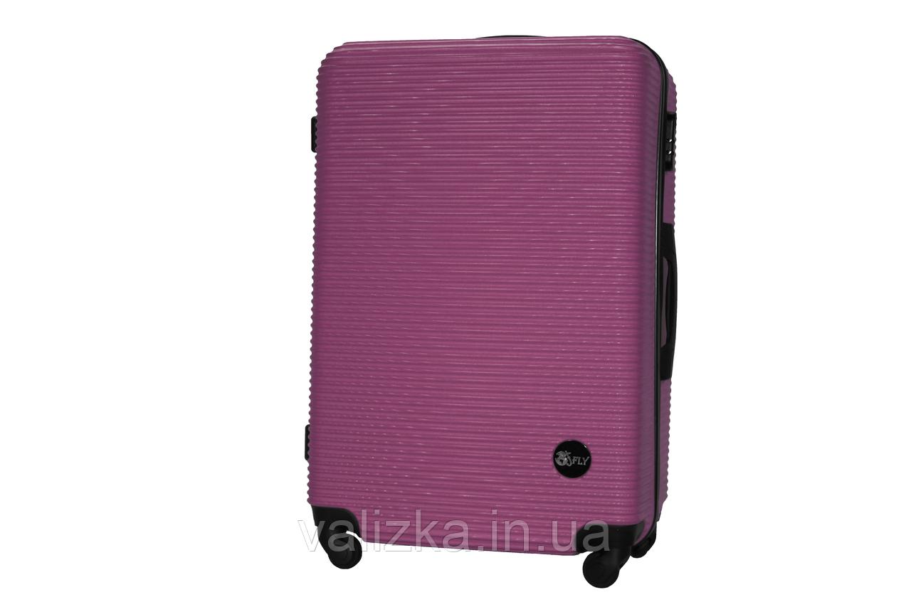 Большой пластиковый чемодан на 4-х колесах темно-фиолетовый Fly