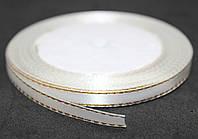 Лента атласная с люрексом ЗОЛОТО. Цвет - белый. Ширина 0,7см, длина - 23м