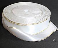 Лента атласная с люрексом золото. Цвет - белый. Ширина - 2,5см, длина - 23м