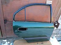 Дверь задняя для Mitsubishi Carisma хетчбек 2000