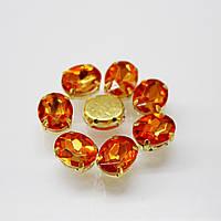 Овалы в золотых цапах.Цвет Orange. Размер 8х10мм.