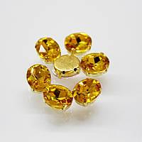 Овалы в золотых цапах Topaz 6х8мм