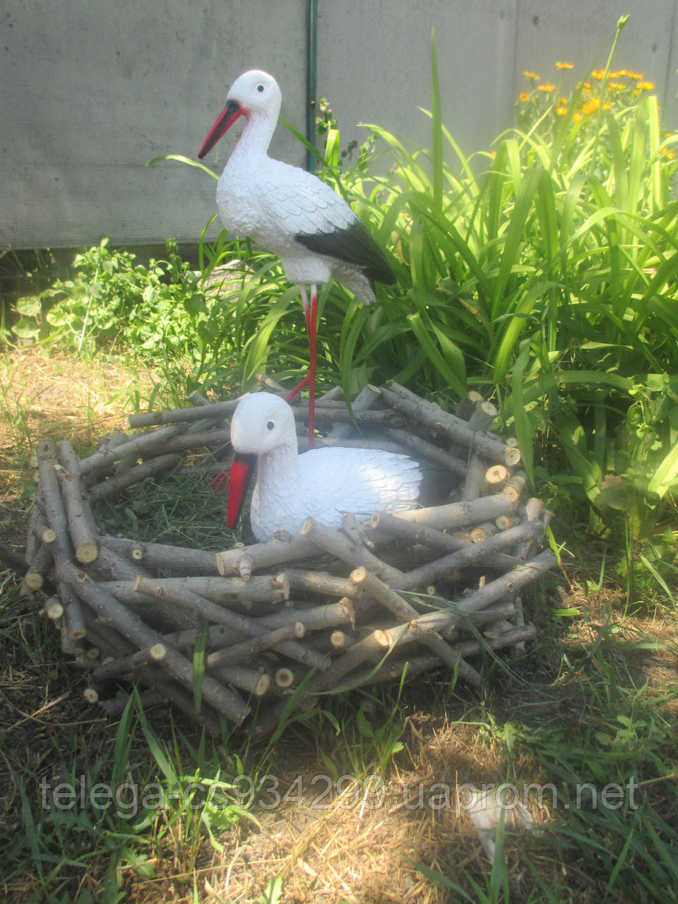 Два аистенка в гнезде