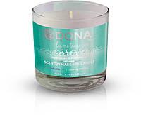 Массажная свеча DONA Scented Massage Candle Sinful Spring NAUGHTY (135 гр). Массажные масла и кремы