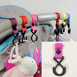 Гачки для коляски (пластик, рожеві)
