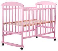 Детская кроватка дерево розового цвета