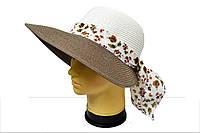Женская шляпа с ярким  цветочным элементом
