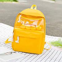 Желтый рюкзак с уточками и прозрачным карманом однотонный.