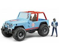 Игрушка Bruder Внедорожник Jeep Cross country с фигуркой гонщика 1:16 (02541), фото 1