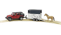 Игрушка Bruder Внедорожник Jeep Wrangler Unlimited  Rubicon с прицепом - коневозкой и лошадью 1:16 (02926)