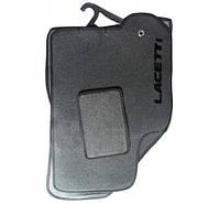 Коврики ворсовые Chevrolet Lacetti черные с перемычкой (пластиковая основа+шип) текстиль
