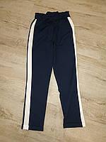 Штани для дівчинки 8-12 років синього кольору з поясом оптом