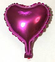 Фольгированный шар в форме сердца малиновое 10″