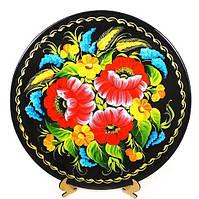 Дерев'яна тарілка в великі червоні квіти
