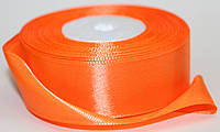 Лента атласная. Цвет - ярко-оранжевый. Ширина - 2,5см, длина - 23м