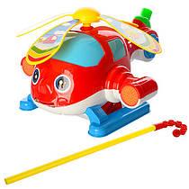Каталка 0362 на палиці, гелікоптер, рухомі лопасті, в кульку, 21-24-14 см.