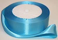 Лента атласная. Цвет - ярко-голубой. Ширина - 2,5см, длина - 23м