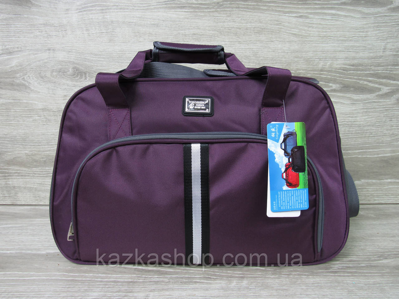 Дорожная сумка хорошего качества, среднего размера 50х33х23 см, плотный материал