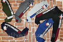 Спортивные штаны для мальчика на 9-12 лет серого, синего, хаки, черного цвета с надписью оптом