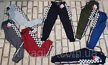 Спортивные штаны для мальчика на 9-12 лет серого, синего, хаки, черного, бордового цвета с надписью оптом