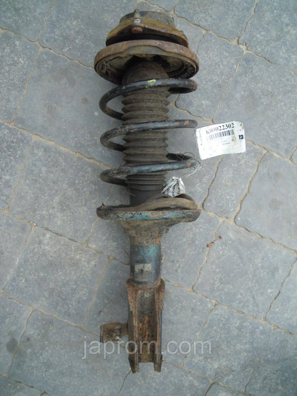 Амортизатор стійка передня в зборі лівий Mazda 323 BA 1994-1997р.в. бензин
