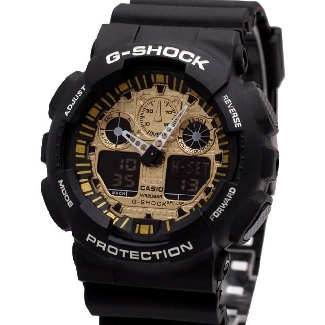 Спортивные часы Casio G-Shock GA 100 черные с золотым