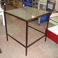Стеклянные столы на кованном  основании