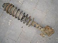 Амортизатор стойка в сборе передняя левая Nissan Micra K11 1992-2002г.в.