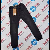 Подростковые джинсовые брюки на резинке и манжетах для мальчиков оптом  GRACE   134---164см.