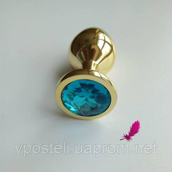 Средняя золотистая анальная пробка с голубым кристаллом