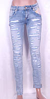 Модные женские джинсы с рванкой