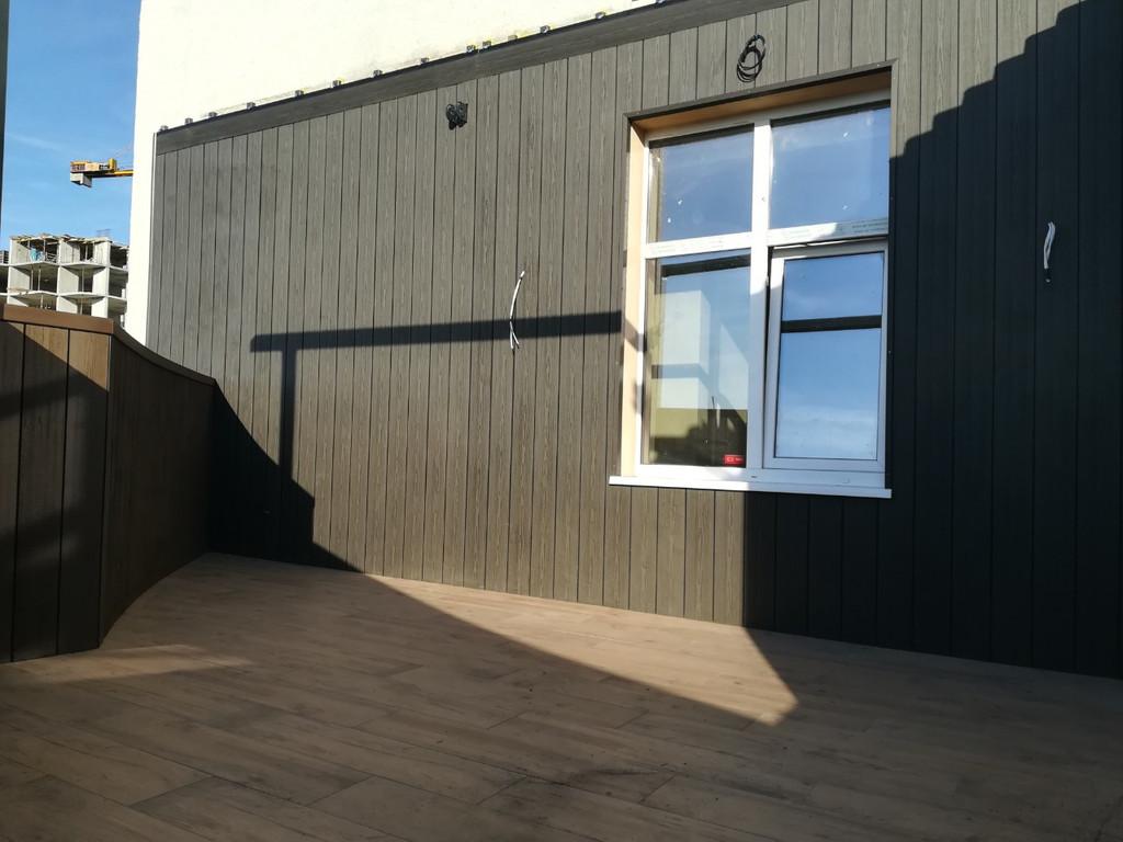 Фасад и парапет из сайдинга Polymer & Wood из ДПК в г. Киев