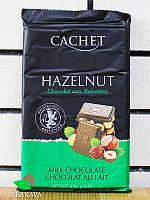 Шоколад молочный с лесными орехами Cachet Milk Chocolate Hazelnut 32%, 300 г