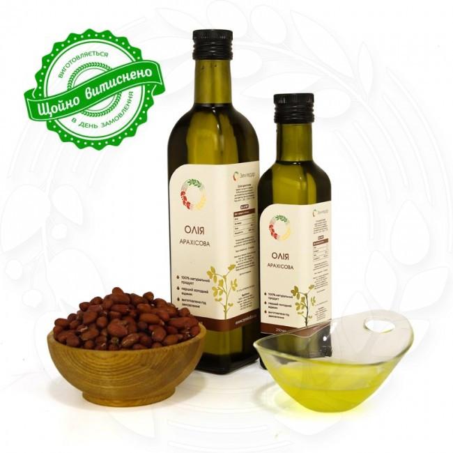 Арахисовое сыродавленное масло в бутылке