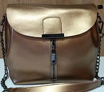 Женская сумка из натуральной кожи золотистого цвета