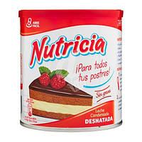 Сгущённое обезжиренное молоко Nestle Тutricia 1040 г Испания