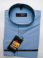 Рубашка на мальчика 6-13 лет приталенная с длинным рукавом голубого цвета с окантовкой оптом