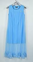 Нежно голубое платье с удлиненным низом из кружева.