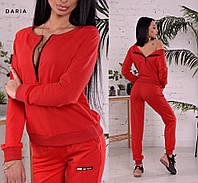 Костюм женский спортивный.Можно носить, как с молнией на спинке, так и впереди. цвет-красный и черный.