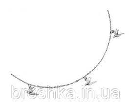 Серебряная цепочка с подвесками в виде птиц